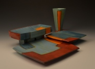 "Place Setting. 2016. 9""h x 16""w x 16""D. Thrown and hand built cone 3 red clay, underglaze and glaze. Electric Fired."